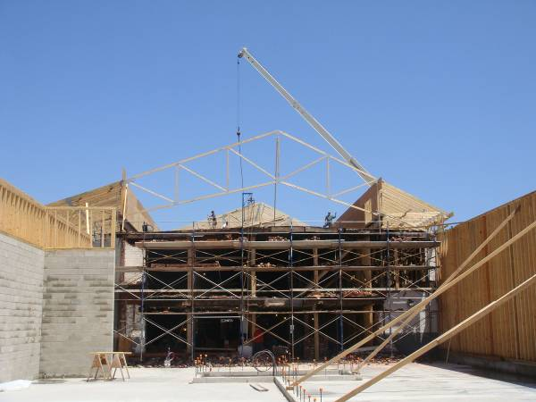 Mcbrie llc structural design steel joist metal roof for Pre engineered roof trusses